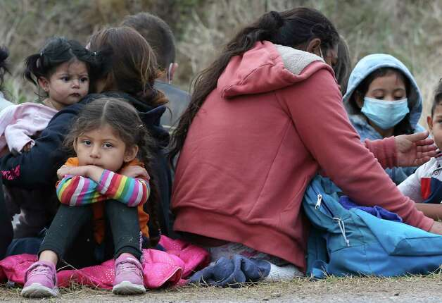A young migrant child waits with family after they were detained by U.S. Border Patrol agents with help from Texas Department of Public Safety troopers just west of La Joya, Texas, Friday April 2, 2021. Photo: Jerry Lara, San Antonio Express-News / **MANDATORY CREDIT FOR PHOTOG AND SAN ANTONIO EXPRESS-NEWS/NO SALES/MAGS OUT/TV   © 2019 San Antonio Express-News