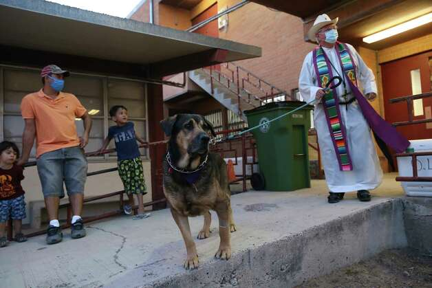 After celebrating a Lenten season evening mass, Rev. Roy Snipes, of Our Lady of Guadalupe Church in Mission, Texas, greets migrants spending the night at the church's parish hall, Thursday, March 25, 2021. The church is one of several where Catholic Charities of the Rio Grande Valley sends their overflow due to COVID-19 restrictions. Photo: Jerry Lara, San Antonio Express-News / **MANDATORY CREDIT FOR PHOTOG AND SAN ANTONIO EXPRESS-NEWS/NO SALES/MAGS OUT/TV   © 2019 San Antonio Express-News