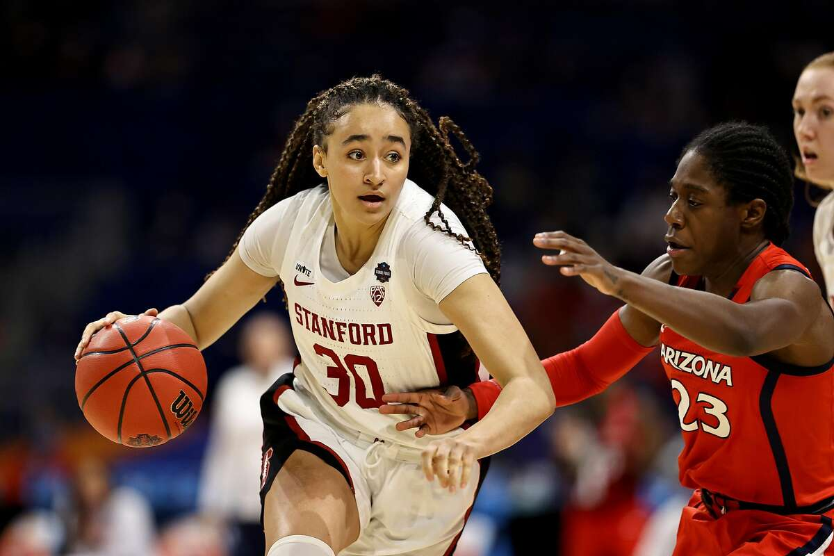 Haley Jones of the Stanford Cardinal brings the ball up the court against Bendu Yeaney of the Arizona Wildcats.