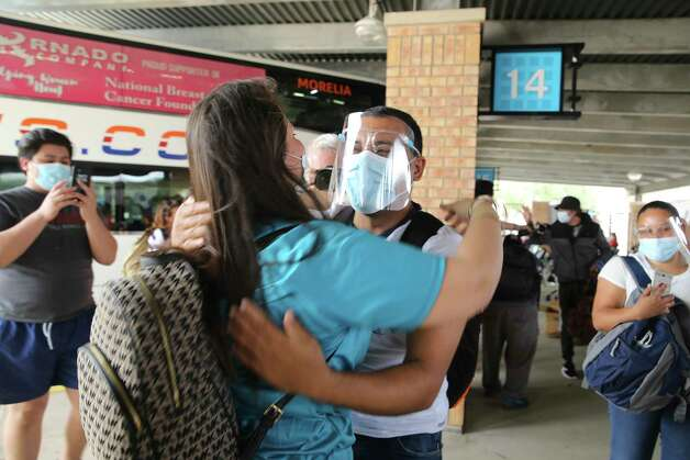 Asylum seekers are greeted by charity volunteers at the Brownsville, Texas bus station, Thursday, Feb. 25, 2021. The group of 27 were the first allowed to enter the U.S. from a migrant camp in Matamoros, Mexico. The camp sprang up when the Trump administration implemented the Migrant Protection Program, which returned migrants back to Mexico to fight their asylum case before U.S. Immigration judges virtually. On Thursday, The Biden administration started allowing the asylum seekers entry into the U.S. Photo: Jerry Lara, San Antonio Express-News / **MANDATORY CREDIT FOR PHOTOG AND SAN ANTONIO EXPRESS-NEWS/NO SALES/MAGS OUT/TV   © 2019 San Antonio Express-News