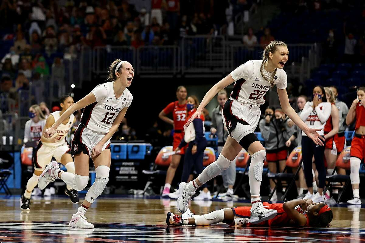 Stanford's Cameron Brink and Lexie Hull run past Arizona's Aari McDonald after McDonald misfired on her last-second shot, allowing the Cardinal to hold on to win 54-53 in Sunday's national championship game.