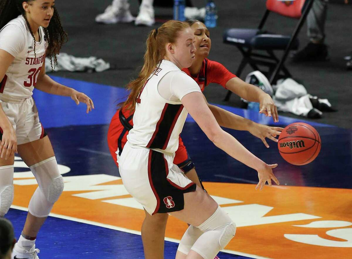 Stanford's Ashten Prechtel and Arizona's Helena Pueyo (13) fight for a rebound during their 2021 NCAA Women's Final Four National Champion basketball game at the Alamodome on Sunday, Apr. 4, 2021.