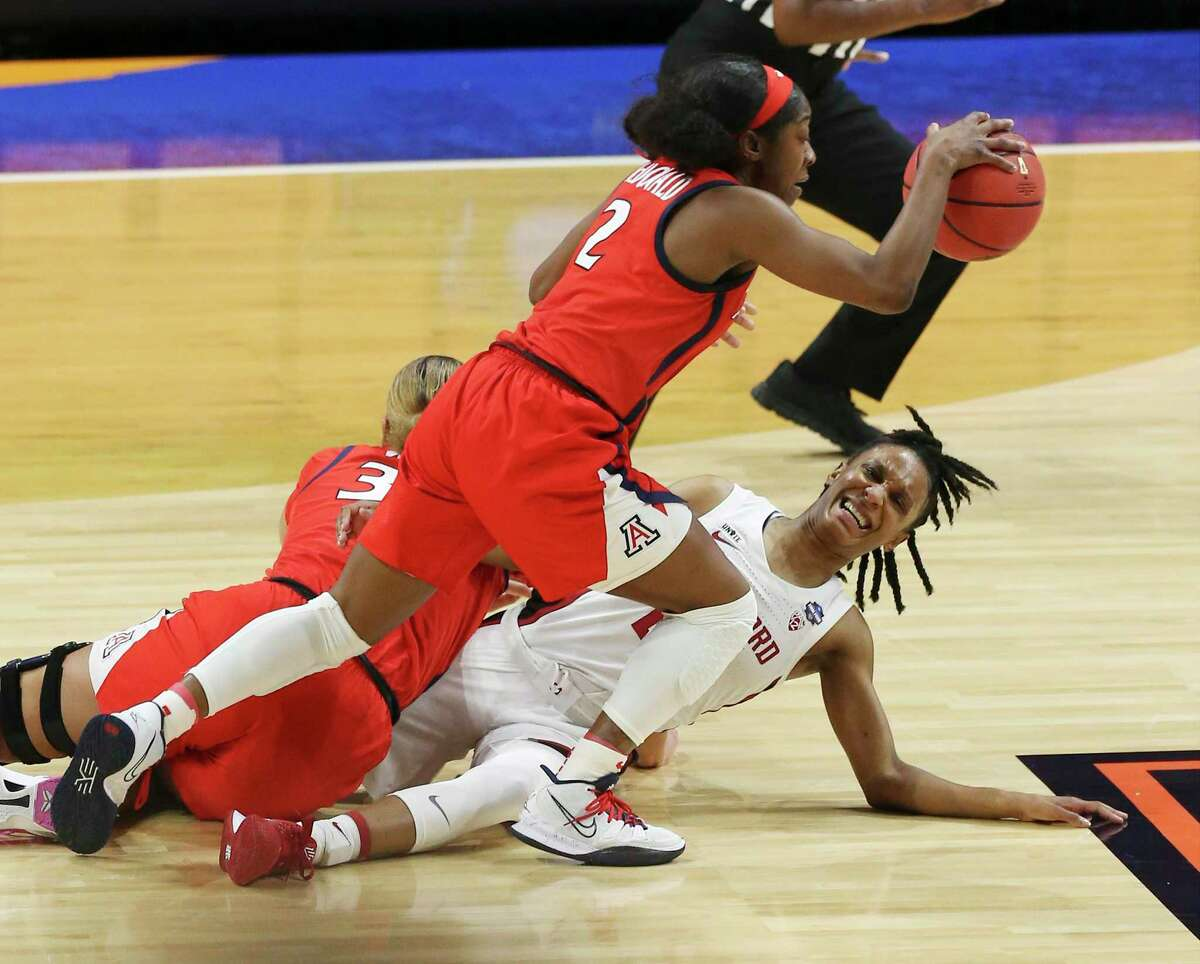 Arizona's Aari McDonald (02) gets a steal against Stanford's Kiana Williams (23) during their 2021 NCAA Women's Final Four National Champion basketball game at the Alamodome on Sunday, Apr. 4, 2021.