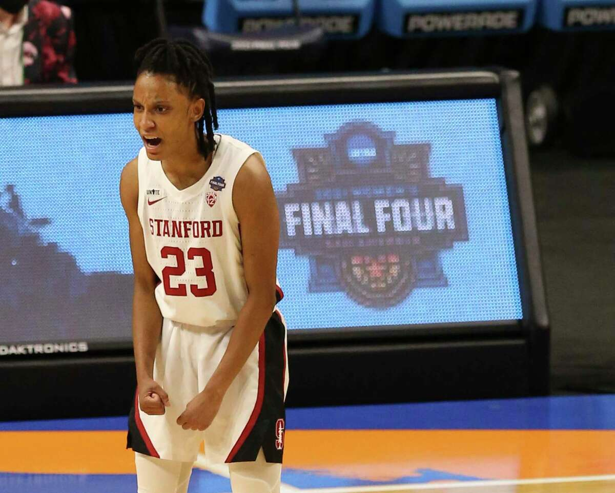 Stanford's Kiana Williams, a Wagner grad, reacts after a 3-pointer against Arizona on Sunday.