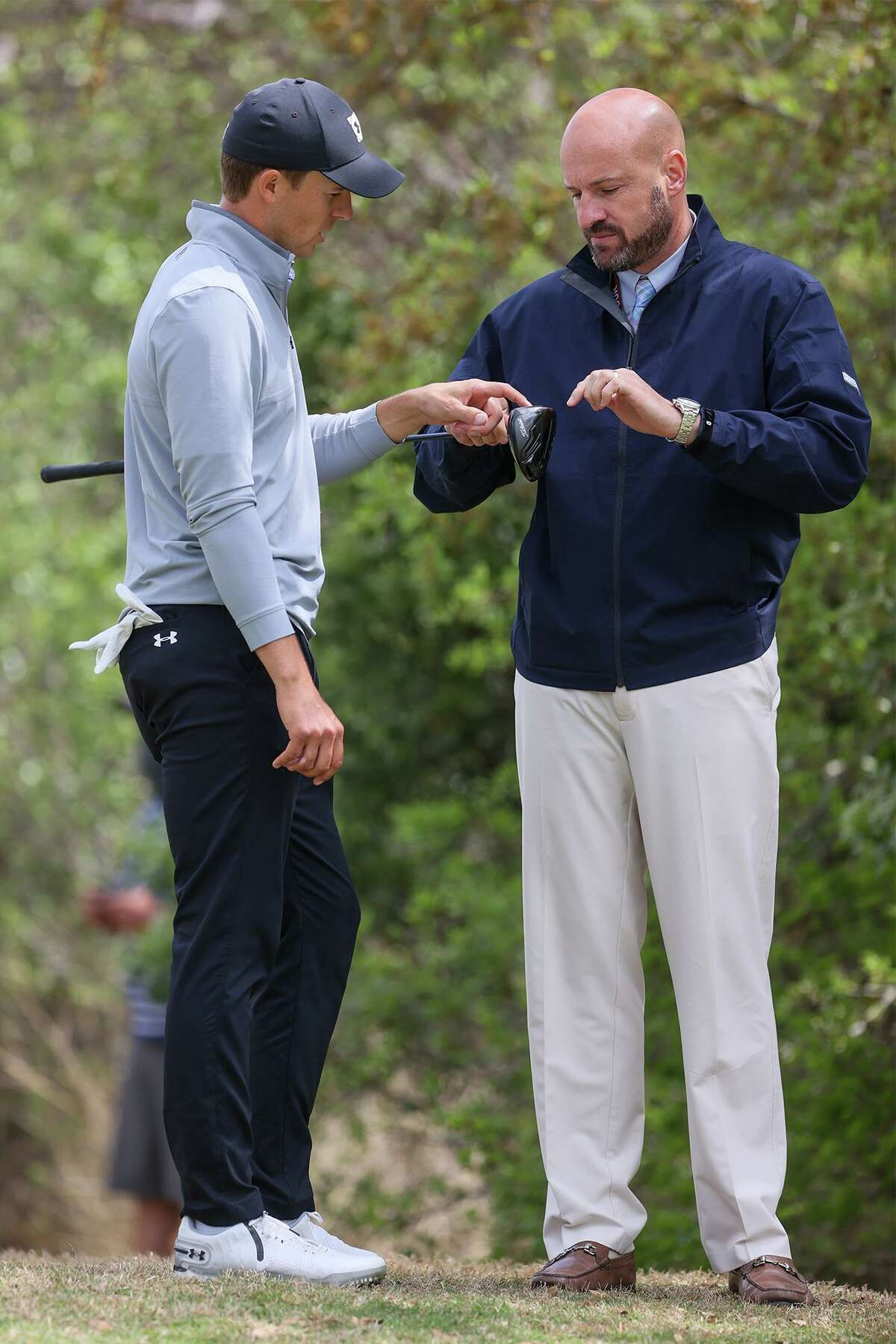 Jordan Spieth talks to a course official about his driver before teeing off on No. 1 during the final round of the Valero Texas Open at the TPC San Antonio - AT&T Oaks Course on Sunday, April 4, 2021.