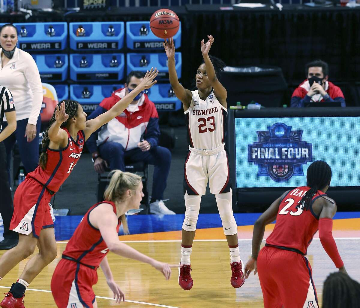 Stanford's Kiana Williams (23) launches a three against Arizona's Sam Thomas (14) during their 2021 NCAA Women's Final Four National Champion basketball game at the Alamodome on Sunday, Apr. 4, 2021.