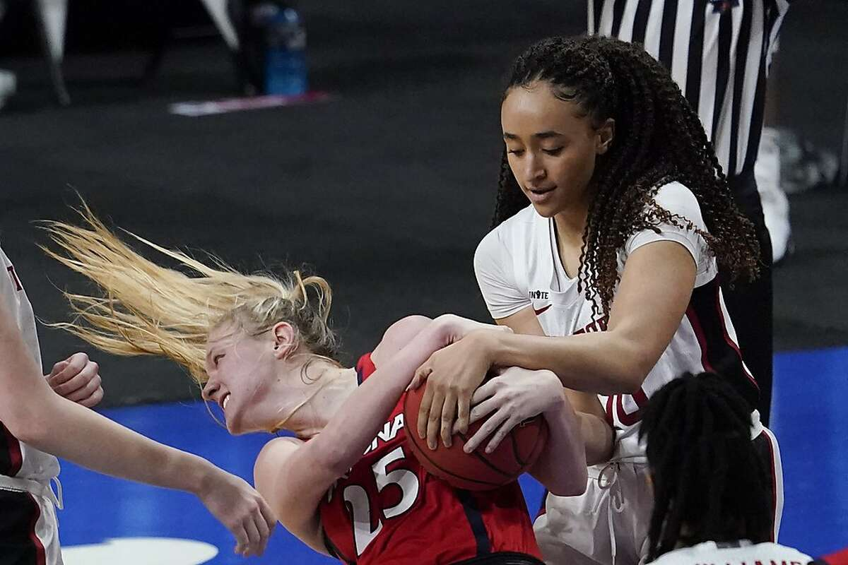 Arizona forward Cate Reese (25) fights for possession of the ball with Stanford guard Haley Jones.