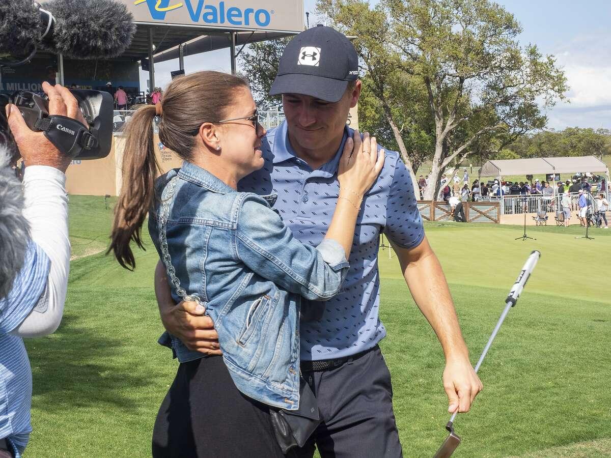 Jordan Spieth hugs his wife, Annie Verret, after ending his PGA Tour victory drought.