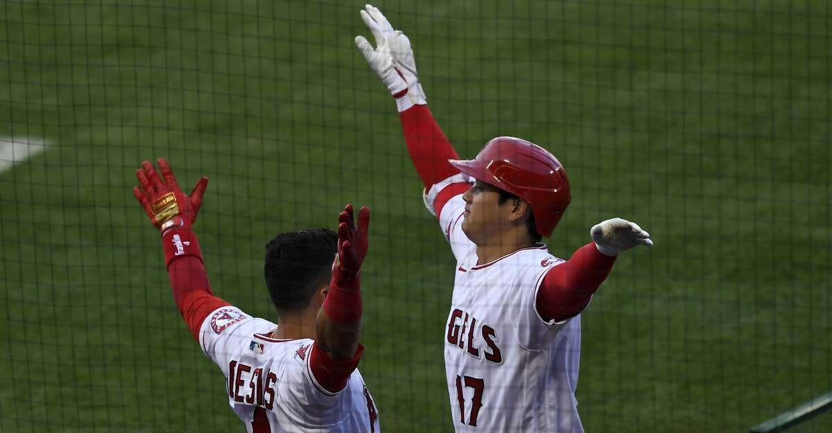 Starting pitcher Shohei Ohtani #17 of the Los Angeles Angels celebrates his one run home run with Jose Iglesias #4 against pitcher Dylan Cease #84 of the Chicago White Sox during the first inning of the game at Angel Stadium of Anaheim on April 4, 2021 in Anaheim, California. (Photo by Kevork Djansezian/Getty Images)