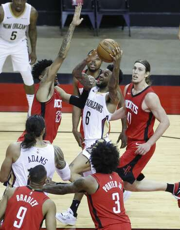 New Orleans Pelicans guard Nickeil Alexander-Walker (6) heads to the basket against Houston Rockets center Christian Wood (35) during the first half of an NBA basketball game at Toyota Center, Sunday, April 4, 2021. Photo: Karen Warren/Staff Photographer / @2021 Houston Chronicle