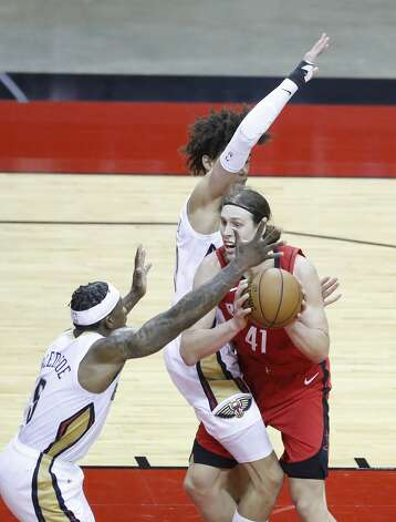 Houston Rockets forward Kelly Olynyk (41) collides with New Orleans Pelicans center Jaxson Hayes (10) during the second half of an NBA basketball game at Toyota Center, Sunday, April 4, 2021. Photo: Karen Warren/Staff Photographer / @2021 Houston Chronicle