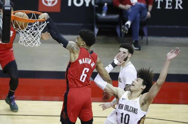 Houston Rockets forward Kenyon Martin Jr. (6) dunks the ball over New Orleans Pelicans center Jaxson Hayes (10) during the second half of an NBA basketball game at Toyota Center, Sunday, April 4, 2021. Photo: Karen Warren/Staff Photographer / @2021 Houston Chronicle