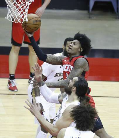 Houston Rockets guard Kevin Porter Jr. (3) goes to the basket against the New Orleans Pelicans defense during the second half of an NBA basketball game at Toyota Center, Sunday, April 4, 2021. Photo: Karen Warren/Staff Photographer / @2021 Houston Chronicle