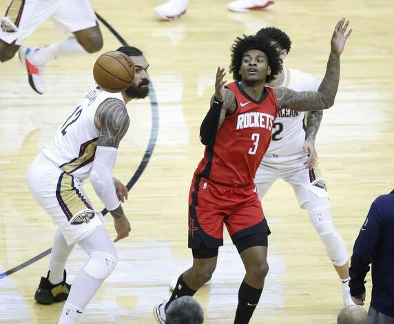 Houston Rockets guard Kevin Porter Jr. (3) loses the ball against New Orleans Pelicans center Steven Adams (12) and New Orleans Pelicans guard Lonzo Ball (2) during the second half of an NBA basketball game at Toyota Center, Sunday, April 4, 2021. Photo: Karen Warren/Staff Photographer / @2021 Houston Chronicle