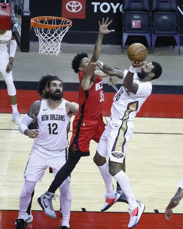 New Orleans Pelicans forward James Johnson (16) heads to the basket against Houston Rockets center Christian Wood (35) during the first half of an NBA basketball game at Toyota Center, Sunday, April 4, 2021. Photo: Karen Warren/Staff Photographer / @2021 Houston Chronicle
