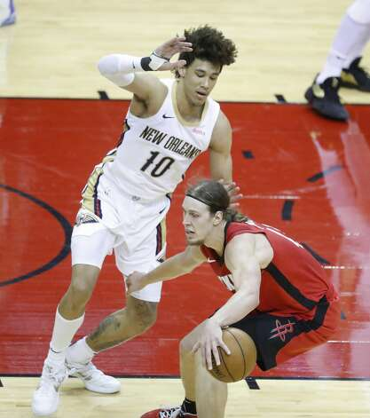 Houston Rockets forward Kelly Olynyk (41) works against New Orleans Pelicans center Jaxson Hayes (10) during the second half of an NBA basketball game at Toyota Center, Sunday, April 4, 2021. Photo: Karen Warren/Staff Photographer / @2021 Houston Chronicle