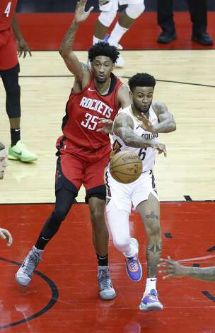 New Orleans Pelicans guard Nickeil Alexander-Walker (6) passes the ball against Houston Rockets center Christian Wood (35) during the first half of an NBA basketball game at Toyota Center, Sunday, April 4, 2021. Photo: Karen Warren/Staff Photographer / @2021 Houston Chronicle