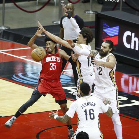 Houston Rockets center Christian Wood (35) battles for a rebound against New Orleans Pelicans centers Jaxson Hayes (10) and Steven Adams (12)during the first half of an NBA basketball game at Toyota Center, Sunday, April 4, 2021. Photo: Karen Warren/Staff Photographer / @2021 Houston Chronicle