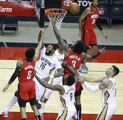 Houston Rockets guard Kevin Porter Jr. (3) goes up to the basket against New Orleans Pelicans forward James Johnson (16) during the second half of an NBA basketball game at Toyota Center, Sunday, April 4, 2021. Photo: Karen Warren/Staff Photographer / @2021 Houston Chronicle