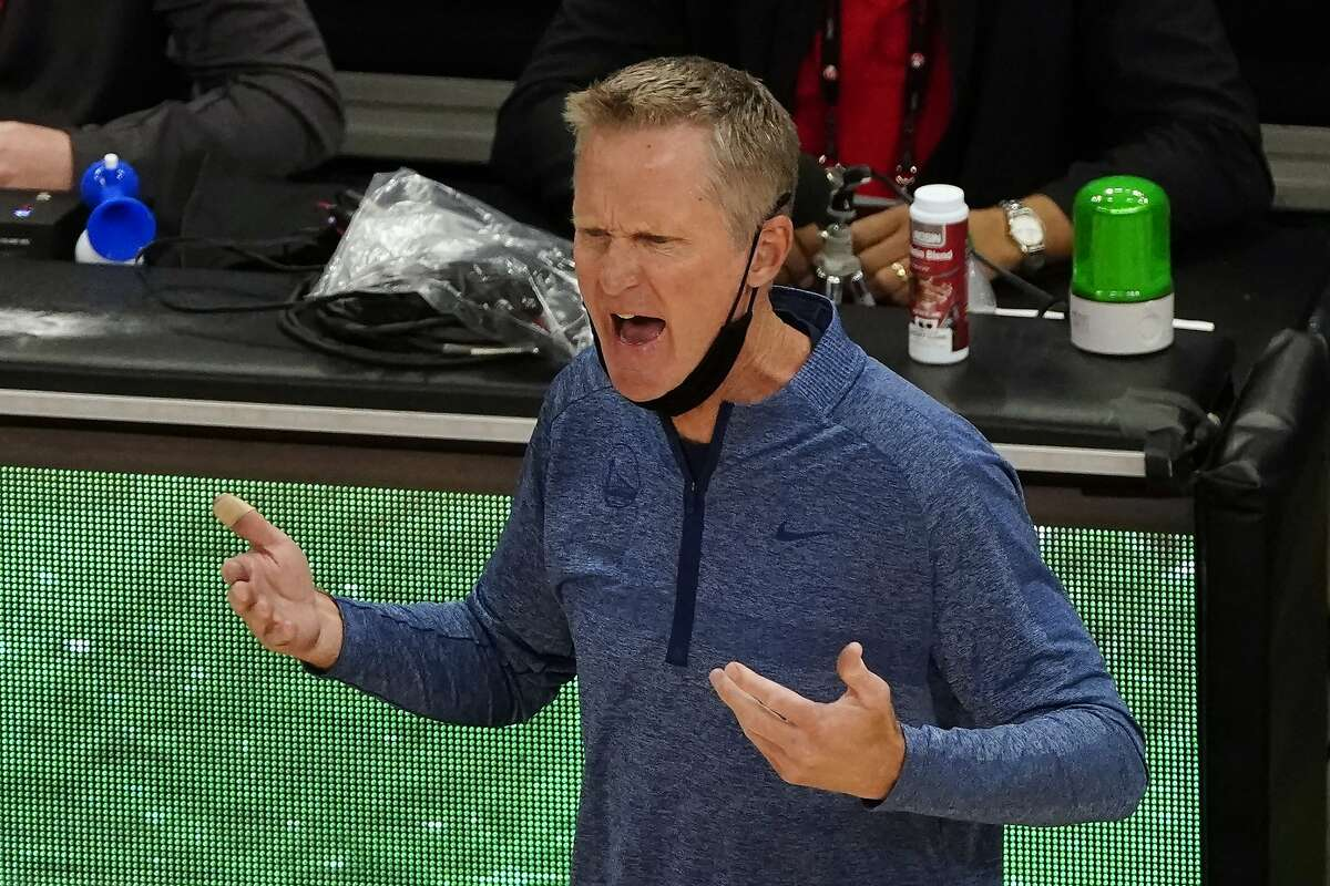 Golden State Warriors coach Steve Kerr speaks with an official during the second half of the team's NBA basketball game against the Atlanta Hawks on Sunday, April 4, 2021, in Atlanta. (AP Photo/John Bazemore)