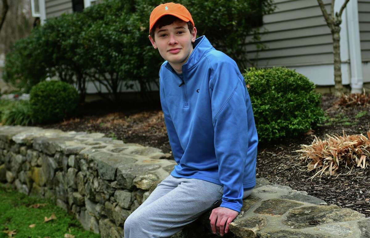 16-year-old, Luke Schwartz at his home Thursday, April 1, 2021, in Wilton, Conn. Schwartz has a rare type of thyroid cancer and a host of other health issues and had hoped that, due to his health issues, he'd get the COVID vaccine early. But, when Lamont went by an age classification, His mother took matters into her own hands and got Luke vaccinated in Vermont, where the family also owns a home.
