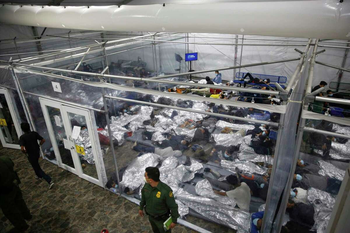 In this March 30, 2021, file photo, minors inside a pod at the Donna Department of Homeland Security holding facility, the main detention center for unaccompanied children in the Rio Grande Valley run by U.S. Customs and Border Protection (CBP), in Donna, Texas.