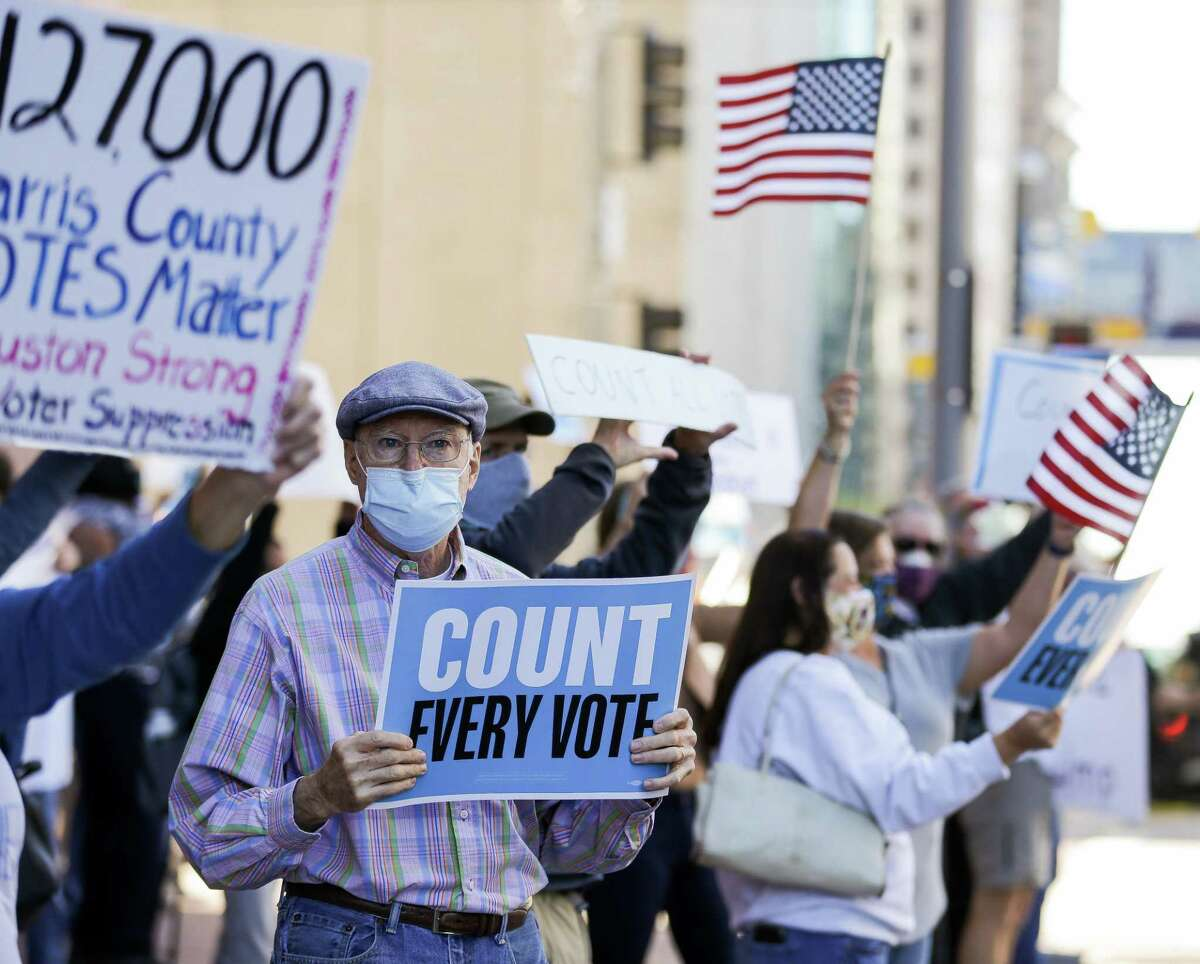 Demonstrators gathered outside the Bob Casey Federal Courthouse to voice their support of drivethrough voting, which was available as an option to cast ballots for early voters in Harris County, on Monday, Nov. 2, 2020, in Houston. Republicans politicians and activists filed a federal lawsuit in opposition to the voting method, which accounted for 127,000 votes.