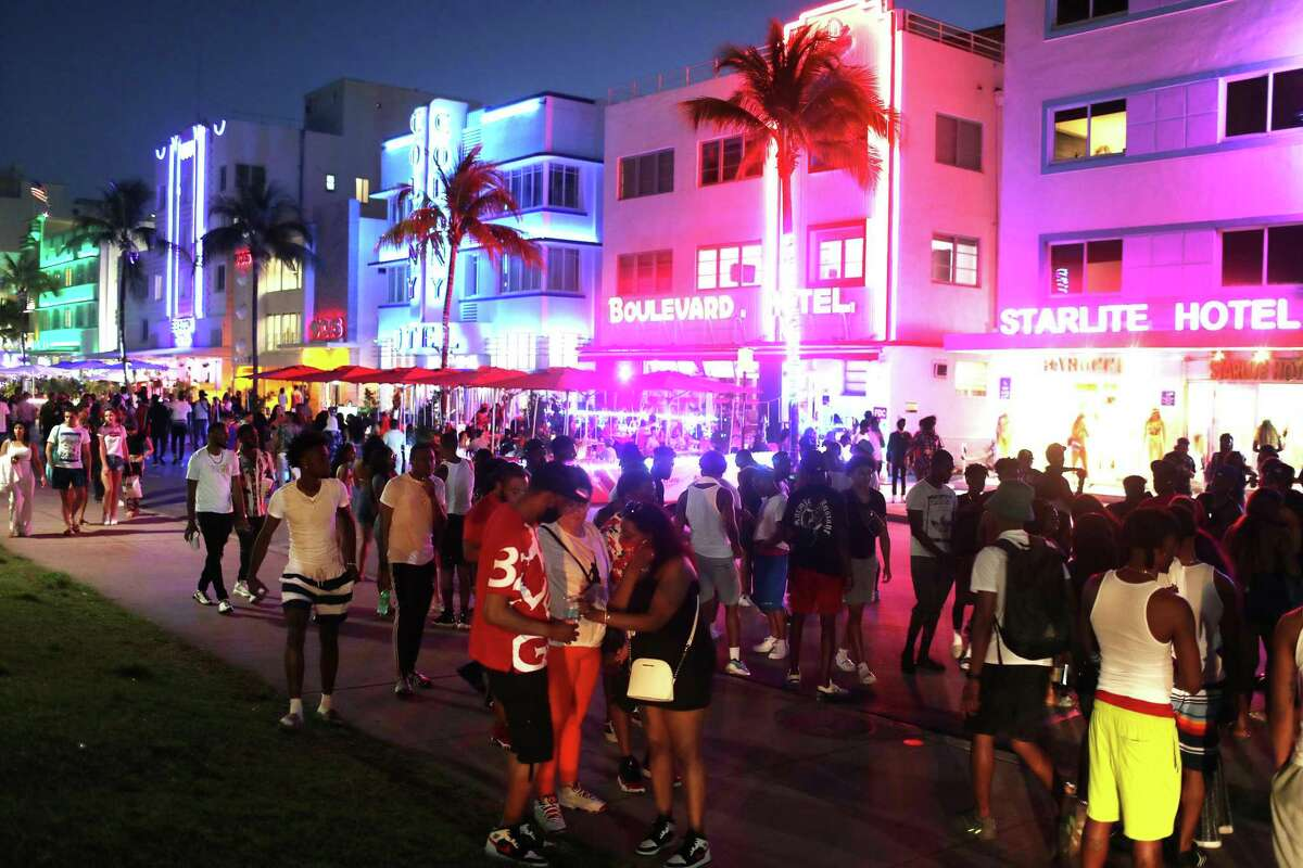 People enjoy themselves as they walk along Ocean Drive on March 18, 2021, in Miami Beach, Florida. College students arrived in the South Florida area for the annual spring break ritual.
