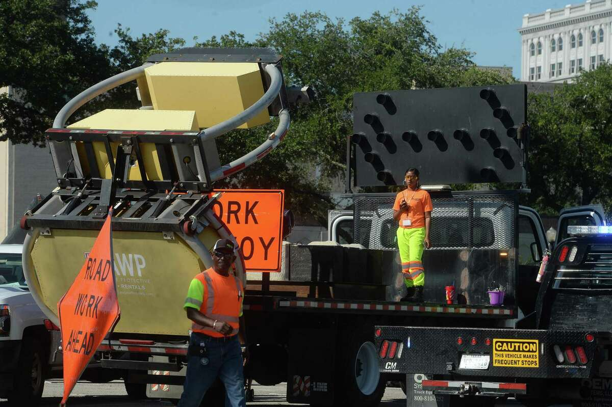 A road work team stands near their vehicle during the Beaumont Children's Museum's annual Touch-a-Truck fundraiser Saturday. Photo taken Saturday, October 19, 2019 Kim Brent/The Enterprise