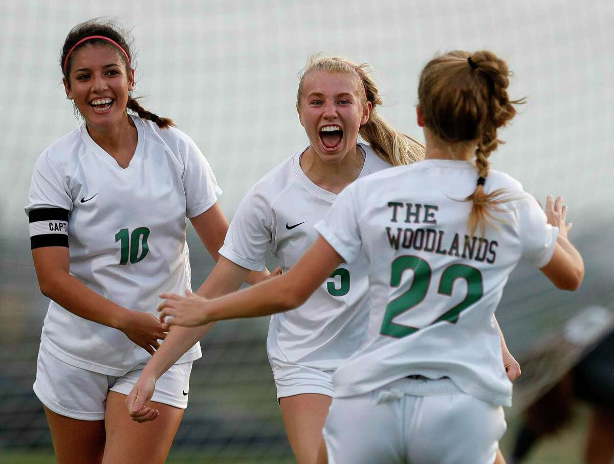 FILE PHOTO - The Woodlands midfielder Courtney Koehler (5) reacts with midfielder Ivana Palomo (10) and defender Janey Kauppinen (22) after scoring a goal during the first period of a high school girls soccer playoff match at Klein Oak High School, Tuesday, March 30, 2021, in Spring.