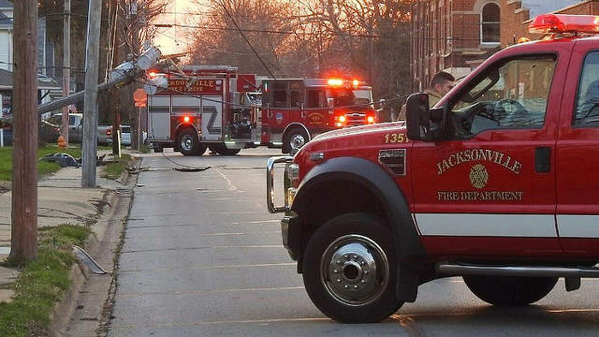 A power pole hangs feet above the road Sunday in the 500 block of West Lafayette Avenue after witnesses said a driver ran into the pole, nearly shearing it, and then left the scene.