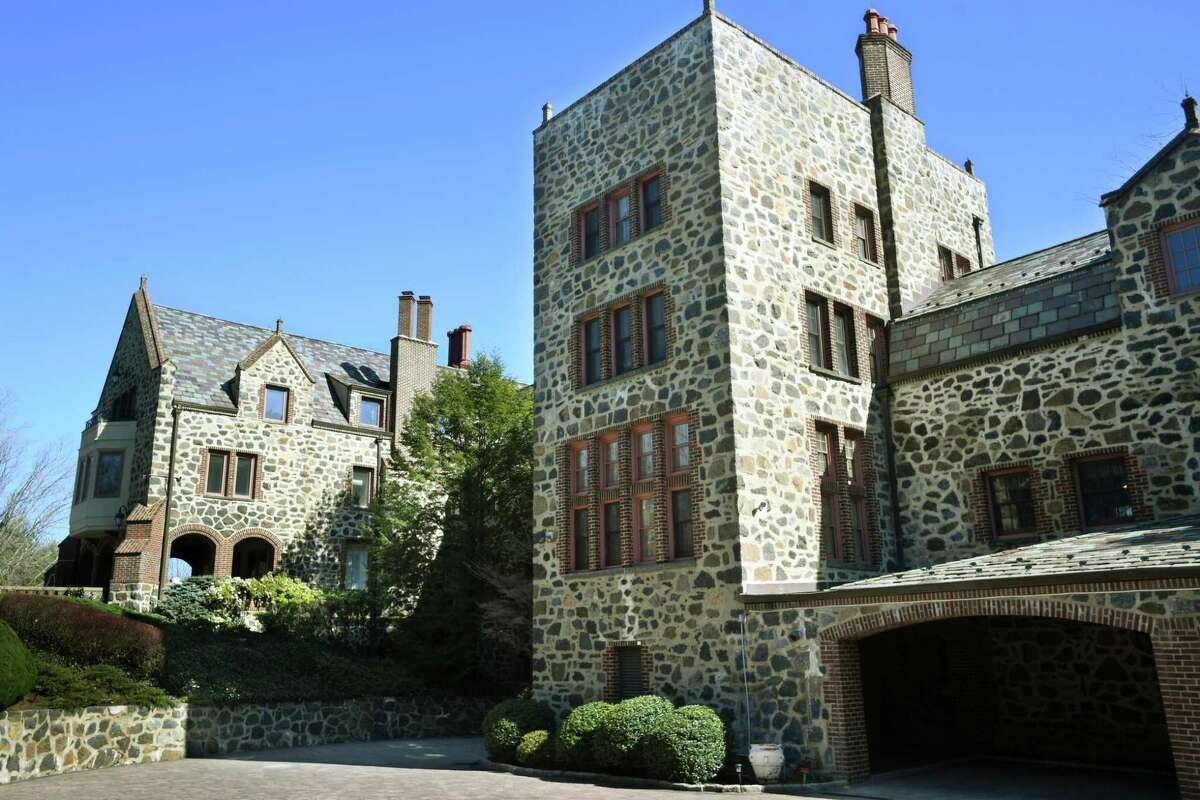 A twenty thousand square foot stone castle home is for sale at 17 Hemlock Drive in Greenwich, Conn. on Monday, March 29, 2021.