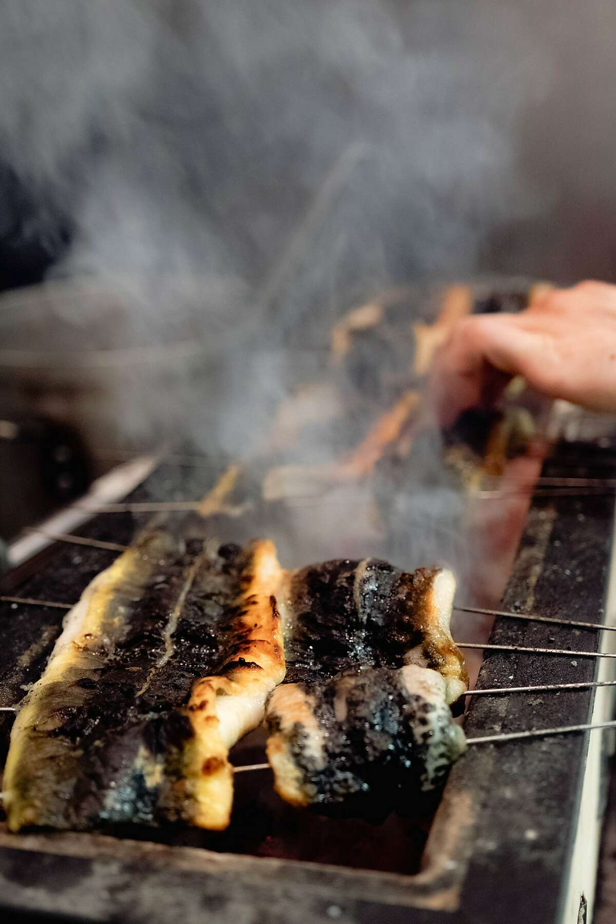David Yoshimura grills American unagi for final course to go with rice during a Nisei pop-up. He'll open Nisei as a brick-and-mortar fine dining restaurant in the former La Folie space in San Francisco.