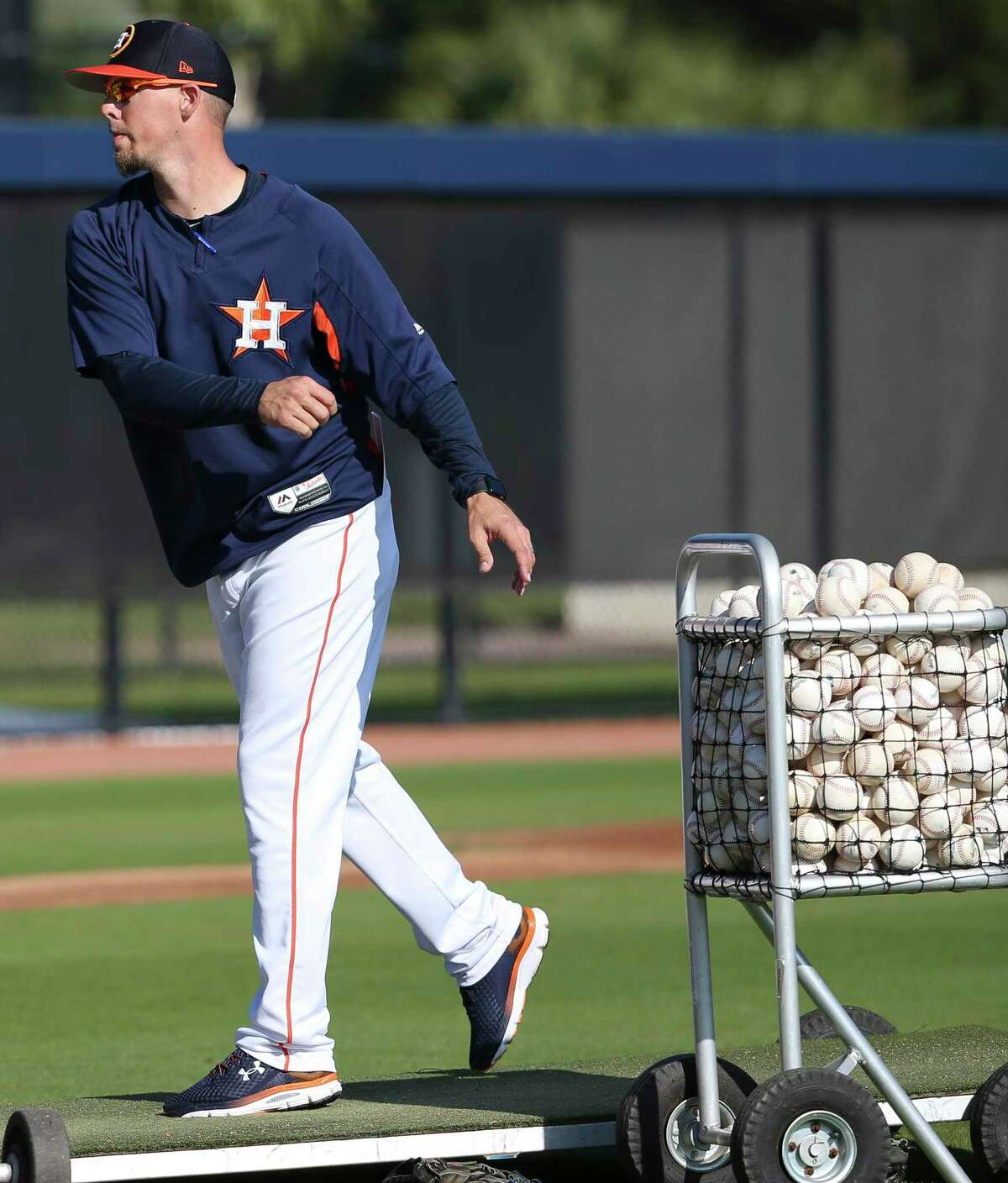 Houston Astros Triple A Sugar Land Skeeter manager Mickey Storey throws to warm up before practice of spring training at Fitteam Ballpark of The Palm Beaches on Sunday, Feb. 17, 2019, in West Palm Beach.