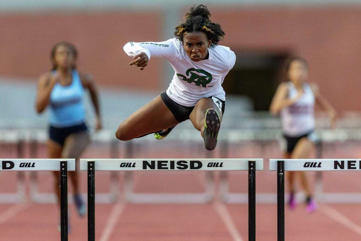 Reagan's Taylen Wise competes Thursday, April 1, 2021 in the 300-meter hurdles during the District 28-6A track and field championships at Heroes Stadium.