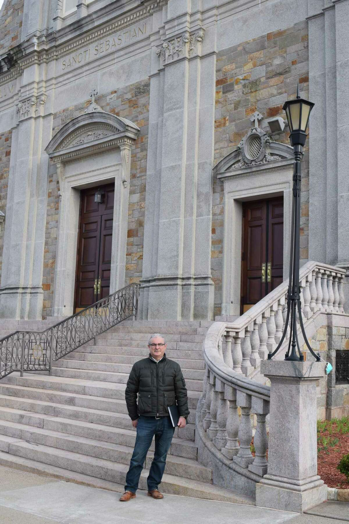 Angelo Glaviano, a Middlesex Community College professor, in front of St. Sebastian Roman Catholic Church in Middletown.