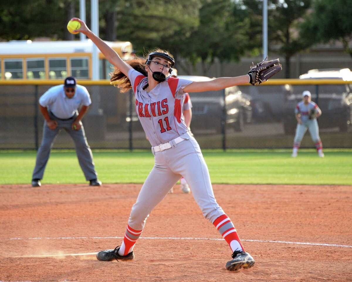 Rachel Ybarra (11) of Travis delivers a pitch in the third inning of a bi-district playoff game between the Mayde Creek Rams and the Travis Tigers on Friday April 27, 2018 at Mayde Creek High School.