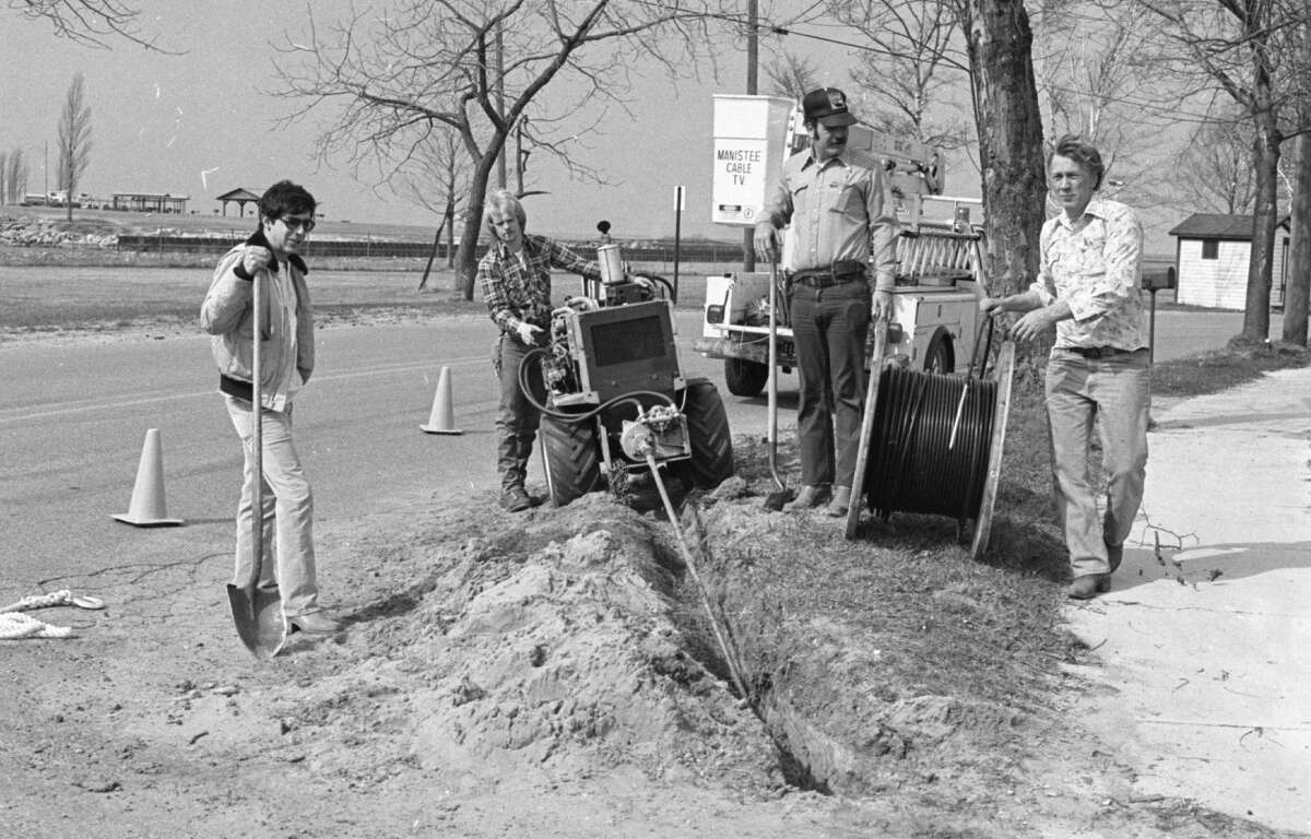 Crews of Great Lakes Cable company were busy last week placing cable by the Fifth Avenue Beach area. The photo was published in the News Advocate on April 6, 1981. (Manistee County Historical Museum photo)