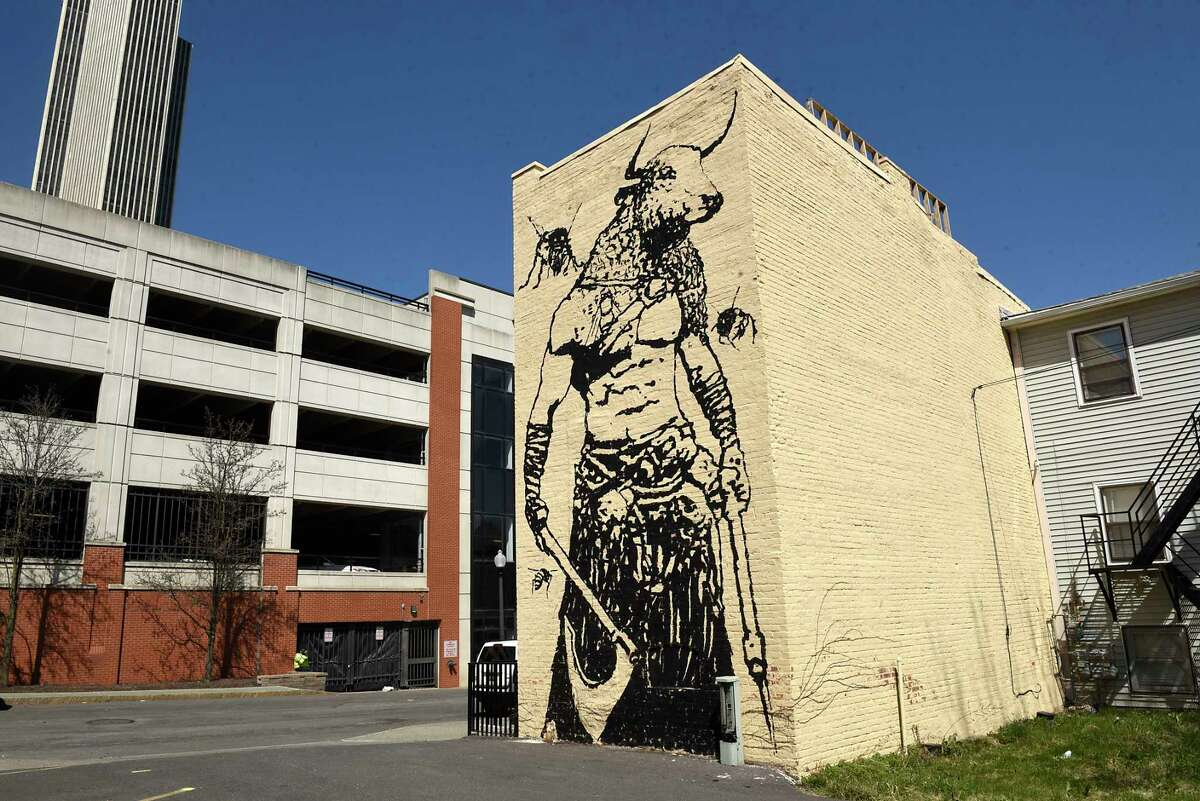 A mural with a Minotaur and bees is seen on the exterior of the Bull and Bee tasting room on Monday, April 5, 2021 in Albany, N.Y. The tasting room offers mead as well as other alcoholic drinks. (Lori Van Buren/Times Union)