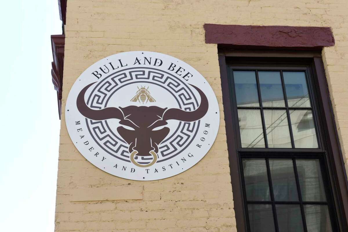 A sign is seen on the exterior of the Bull and Bee tasting room on Monday, April 5, 2021 in Albany, N.Y. The tasting room offers mead as well as other alcoholic drinks. (Lori Van Buren/Times Union)