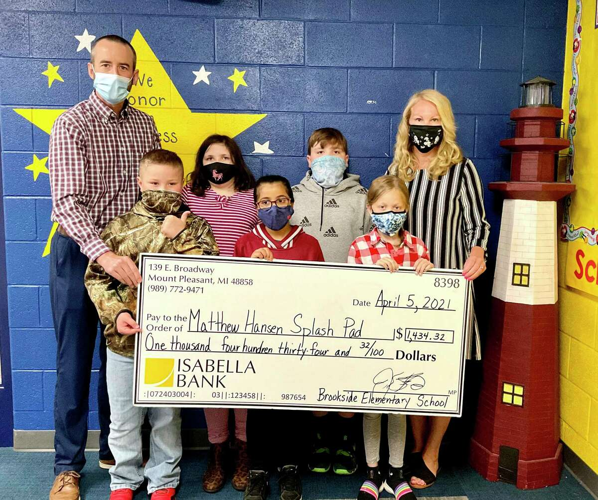 On Monday, Brookside Elementary students presented a check for over $1,400 to Jon Cole, chairperson of the Hemlock Park Improvement Project. The funds were raised through a month-long coin drive and will go toward the Matthew Hansen Memorial Splash Pad. (Courtesy photo)