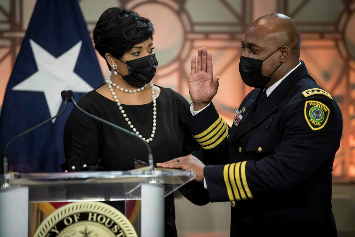 New Houston Police Chief Troy Finner, right, stands with his wife, Sherrian, as he is sworn in as the department's newest chief during a ceremony at City Hall Monday, April 5, 2021 in Houston. Finner is a 54-year-old veteran who hails from Fifth Ward and attended Madison High School in Houston. He formally takes the reins of the police department the same day that outgoing Chief Art Acevedo is sworn in as chief in Miami.