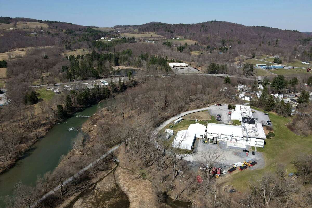 View of the Saint-Gobain Performance Plastics plant on Monday, April 5, 2021, near the Hoosic River in Hoosick Falls, N.Y. PFOAs, or perfluorooctanoic acid, leaked into the Hoosick Falls municipal water system and nearby private wells from St. Gobain and Honeywell plants that made anti-stick chemicals. PFOAs are a key ingredient in these substances which are used in products like Teflon. The production plant has since phased out the use of PFOA.