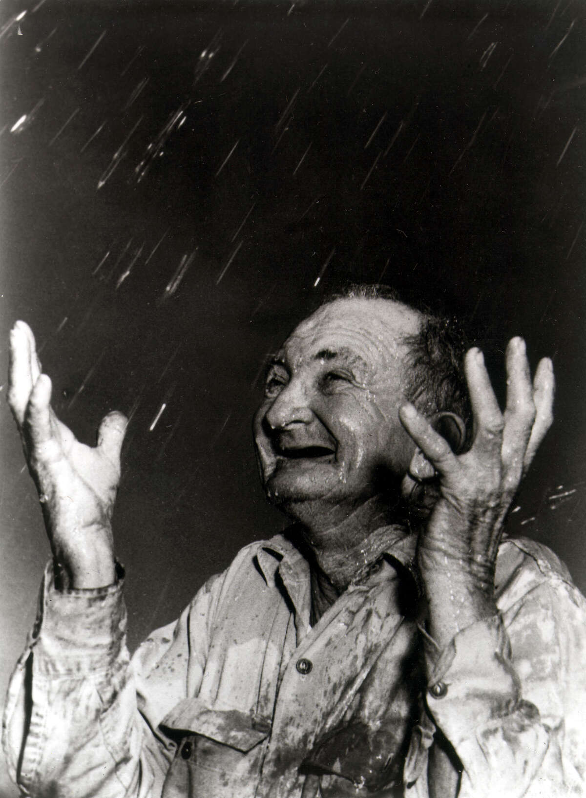 In this 1951 photo of Sam J. Smith, a San Antonio farmer, is elated by the rain during the severe drought. The photo, taken by former San Antonio Light photographer Harvey Belgin, was a finalist for a Pulitzer Prize in 1952. The photo was highlight on Sunday, April 4, 2021, by Traces of Texas Twitter account.(Harvey Belgin/San Antonio Light) This photo now belongs to the Institute of Texan Cultures, which used it in a 1998 exhibit about Texas weather.