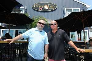 Niall O'Neill and Chris Delmonico of of the former Crabby Dog Tavern, in Stratford, were ordered by a judge to stop retaliating against employees.