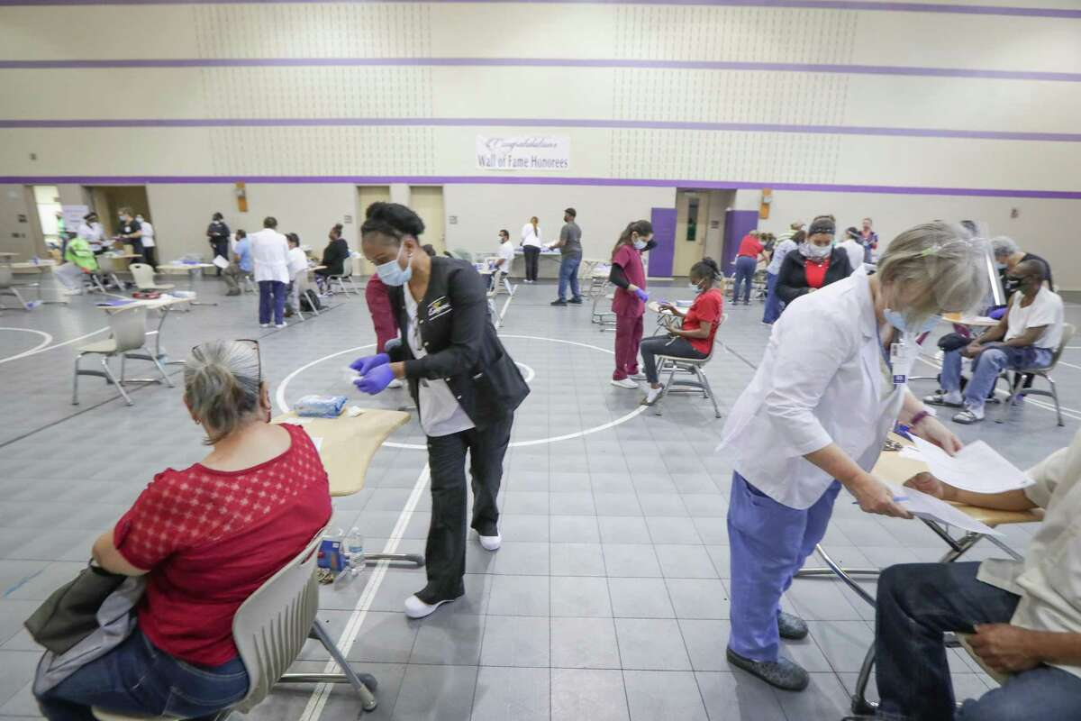 Nurses and nursing students were on hand to administer the COVID-19 vaccine at Wheatley High School for a neighborhood outreach vaccination site Friday, April 2, 2021, in Houston.