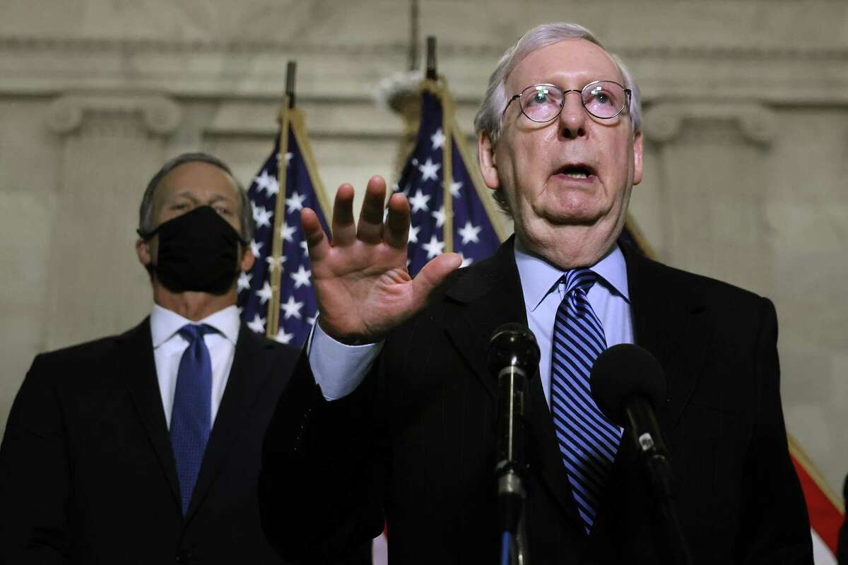 """Senate Minority Leader Mitch McConnell denounces efforts to abolish the filibuster, saying that he would use procedures to turn the Senate into a """"100-car pileup, nothing moving."""" The filibuster rule should be eliminated because of its current abuse and disgraceful past."""