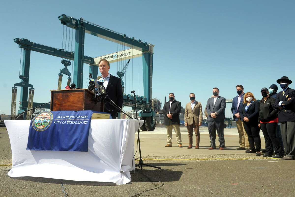 Gov. Ned Lamont speaks at a news conference on the Bridgeport Boatworks property, in Bridgeport, Conn. April 5, 2021. Lamont joined other officials to announce a long-term lease agreement between Bridgeport Boatworks and the Hownblower Group, who run a wide variety of water cruises and ferry services.