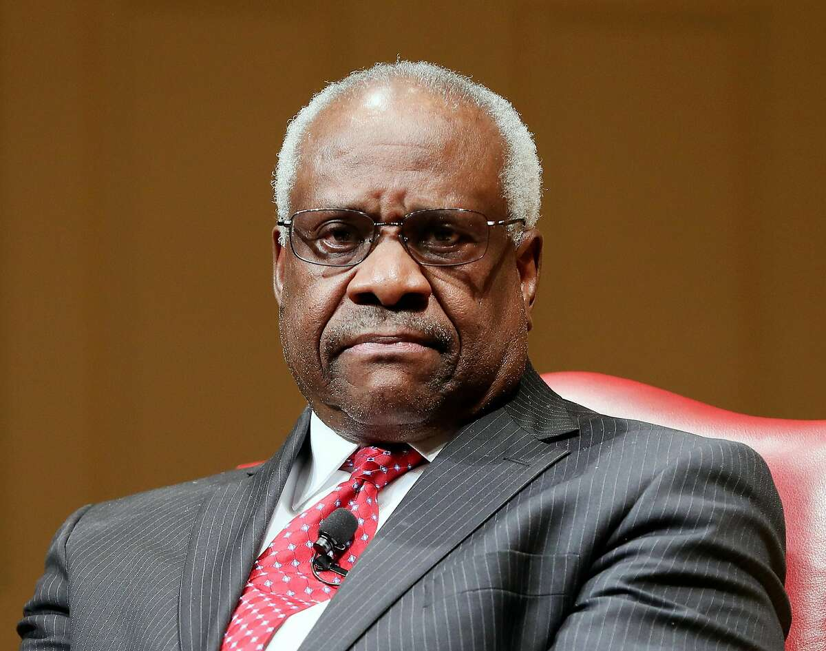 FILE - In this Feb. 15, 2018, file photo, Supreme Court Associate Justice Clarence Thomas sits as he is introduced during an event at the Library of Congress in Washington. Thomas is asking his first questions at Supreme Court arguments in more than three years. Arguments were almost over Wednesday in a case about racial discrimination in the South when the court?•s only African-American member and lone Southerner piped up.(AP Photo/Pablo Martinez Monsivais, File)