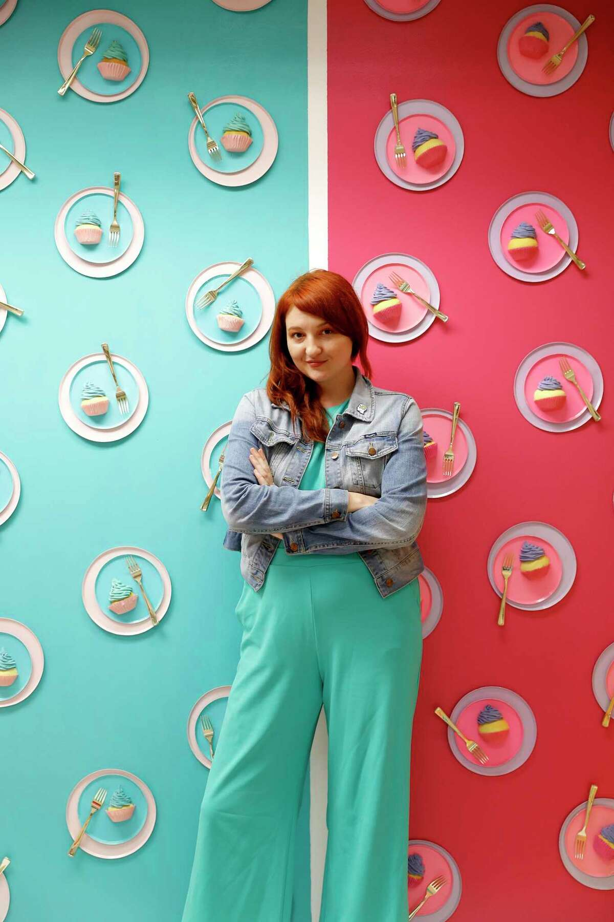"""FOMO Factory founder Rachel Youens in the """"birthday room"""" in the FOMO Factory when it was under construction in the Galleria mall, in Houston. In a suit, Youens' parents said she """"believed that Gallery Furniture ... would get away with stealing her ideas, her dreams and that her business would inevitably fail as a result."""""""